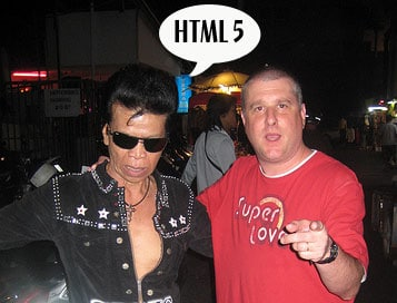 Thai Elvis impersonator with Bruce, speech bubble from Elvis saying 'HTML 5'