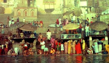 people in saris  bathing in the Ganges