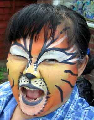 Nongyow, face-painted to look like a tiger