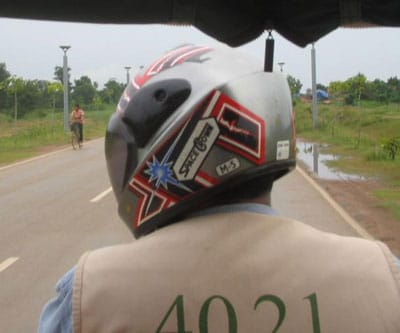 motorcycle rider, with helmet branded 'space crown'