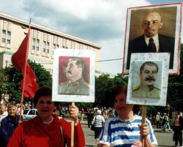 ladies with placards of Lenin and Stalin