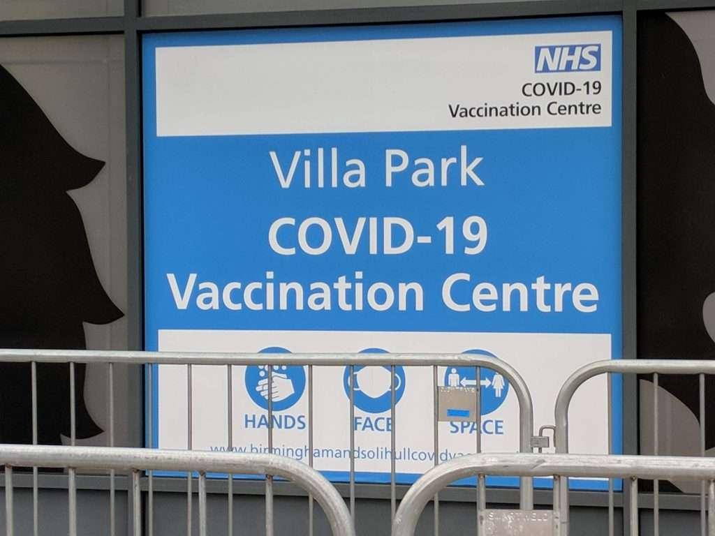 Signpost: Villa park Covid 19 vaccination centre